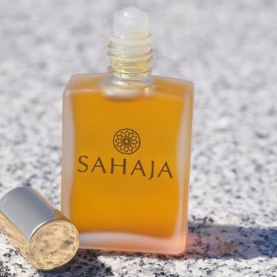 orange perfume top off on rock